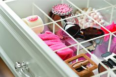 Use existing closet storage drawers for tasteful storing of smalls. I love the dividers.