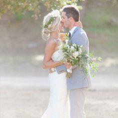 Dreamy California barn wedding with a pretty flower arch + vintage door entrance!
