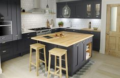 Adding drama to a kitchen, black is an increasingly popular choice for kitchen cabinetry. For those looking to make a more subtle style statement, charcoal is the answer. We love this scheme by Second Nature