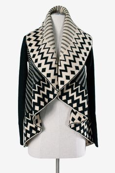 """This black and ivory printed sweater has an oversized collar that drapes nicely around neck and shoulders for a cozy fit perfect for lazy afternoons. The Aztec-inspired geometric print is a must this season.60%cotton, 40�rylic28"""" shoulder to hemMeasurements taken from size small"""