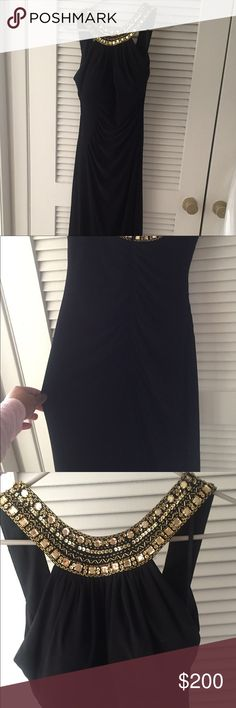"""Black and gold Evening gown/ prom dress Size 4 Has built in bra It's a beautiful dress. I got it for prom, but have no need for it anymore. There are no stains or missing jewels. The stitching is great! It did fit me about 4"""" long but I didn't get it tailored (I'm 5'4"""")  Will upload more photos if you'd like. If you have any questions please let me know! Dresses Prom"""