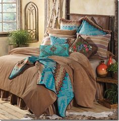 Beautiful turquoise, pink, and tan western bed set. | Stylish Western Home Decorating