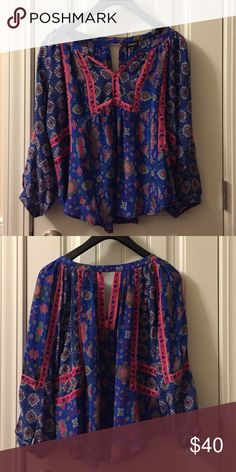 Anthropologie Tolani Blouse This silk Tolani brand Blouse is made of 100% silk and made in India. The vibrant colors are even better in person! Beautiful flowy silhouette with peasant like sleeve. Tolani Tops Blouses