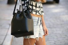 """Jennifer Lawrence wears Alexander Wand Bucket Bag Photo: Purse Blog Let's face it, if JLaw is a fan, then so are we!Harper's Bazaarhails the """"Bucket Bag"""" as one of the """"It"""" bags for 2015, and with celebrities such as Jennifer Lawrence toting it around, it's no wonder everyone's rushing out to pick"""