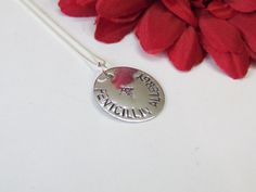 ExpressionsStamped has custom hand stamped a disc with the words Penicillin Allergy with the medical alert stamp as shown in photo. (Can