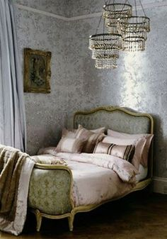 Glamorous bedroom with silk floral wallpaper, 3 chandeliers, and a Louis XV bed.