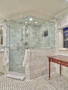 master bathroom shower, like the towel knobs on either side of shower door