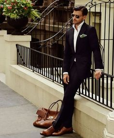 c5c8faf81f83a Classic Black Slim Fit Suit, Crisp White Shirt, Tom Ford Sunglasses, and  Tan Leather Bag. Not the shoes!