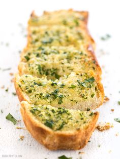 Homemade Garlic Bread is twice as nice for half the price of it's frozen store bought counterpart! Plus it only takes minute to make and can be stored, unbaked, in the freezer. BudgetBytes.com