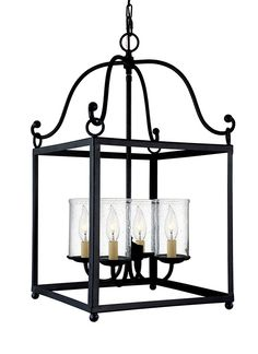 The Declaration lighting collection by Feiss is a series of traditional lanterns featuring open frames finished in Antique Forged Iron. The bulbs are surrounded by Clear Seeded glass shades to add warmth, depth and sparkle. The assortment includes chandeliers, an island chandelier, a wall sconce and a mini-pendant.