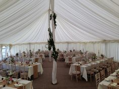 Flower garland dressing the marquee pole