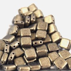 Items similar to Czech Mates 2 Hole tile beads-Metallic Suede Gold- 50 pieces (CZ CM MSG) on Etsy Jewelry Making Supplies, Tile, My Etsy Shop, Chocolate, Beads, Beading, Mosaics, Bead, Schokolade