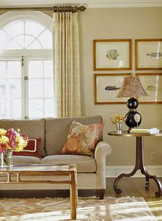 Warm Neutrals   Inspiration for the living room's color scheme came from the floral pillows. Neutrals from oatmeal to cream and taupe covers the walls, windows, and upholstery with quiet color.