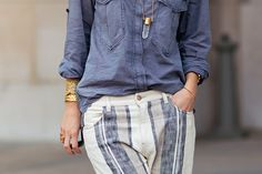 Denim top, crystal necklace, striped pants, gold jewelry