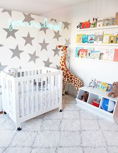 A peek into Jen Ramos' Nursery! A totally neutral white and silver nursery with pop! Like that awesome neon sign that reads - You are so loved.