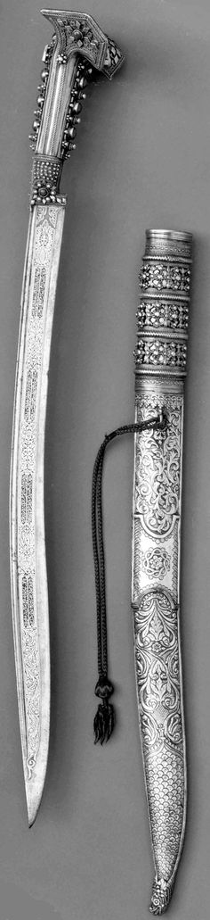 "Ottoman (Anatolian or Balkan) yatagan / yataghan, A.H. 1238/A.D. 1822, steel, silver, gold, coral, Length, 29 1/4 in. (74.3 cm) Length of blade, 22 1/8 in. (56.2 cm), Met Museum, Bequest of George C. Stone, 1935. Inscribed with the date 1238 (A.D. 1822), the name of the maker (""Made by Abdullah""), six Turkish verses of good will towards the owner, and the names of two owners (Ismael Gazi and Abdul Kadar)."