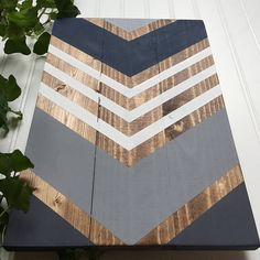 // handcrafted chevron wood sign // Rich with contrast, a bold chevron pattern, and Special Walnut Minwax wood stain, this piece would add a fabulous statement to any modern, stylish space.