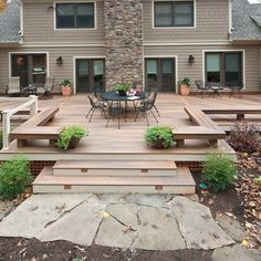 This Ground level deck has a symmetrical look with on one side a railing and and both sides benches wrap around the perimter.