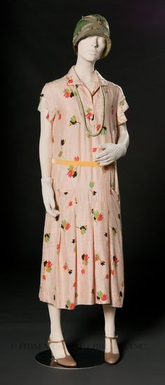 1926 Daydress. The slim, youthful silhouette of 1920s fashion signaled the emergence of a new ideal of feminine beauty. Unlike her predecessors of the late 19th century, who favored the silhouette of a mature, well-endowed woman swathed in layers of fabric, the 1920s woman dressed in a style that emphasized youth. Lightweight daydresses for adult women were designed to expose bare arms and lower legs, parts of the body typically covered by all except young girls.