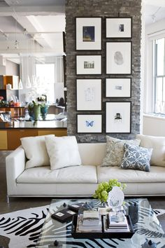 A great way to add visual height to a room is to maximize vertical wall space when arranging framed artwork