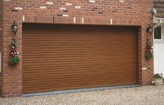 Last year installation of our RSG7000 Electrically Operated Security Roller Garage Doors, golden oak powder coated, to a residence in Harrow.
