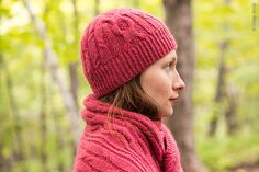 Bering is a wide cabled wrap with a companion hat inspired by a winter walk in the woods. A close up of a knot found in an old tree is juxtaposed with group of young saplings reaching toward the sky in the distance. A large, bold medallion cable representing the old knot is placed amid a group of long, lean cables.