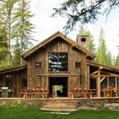 rustic and awesome...LOVE the screen porch and sliding barn doors...