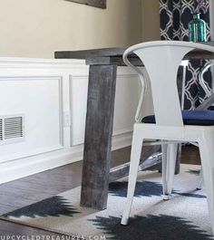 Use fabric medium and acrylic paint to turn a cheap remnant rug into a custom statement piece.