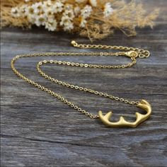 """⚡️SALE⚡️Vintage Deer Antlers Necklace Adorable brand new, vintage gold necklace with a deer horn/antler charm.  The necklace is made from a 14k gold plated zinc alloy. The antler charm itself is approx 1.5"""" wide & 0.75"""" long.  Unfastened, the chain is approx 19 """" long. Jewelry Necklaces"""