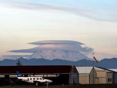 MOUNT MUSHROOM: Lenticular clouds float over Washington's Mount Rainier at sunset.