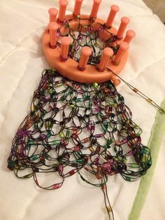 Ladder ribbon yarn scarf in the making using flower loom