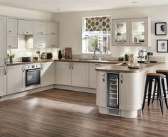 Some nice features in this Burford Cashmere kitchen from Howdens. Like the curved ends and the wine cooler! Kitchen Family Rooms, Living Room Kitchen, Home Decor Kitchen, Kitchen Interior, Kitchen Design, Kitchen Sofa, Kitchen Ideas, Open Plan Kitchen Dining Living, Kitchen Diner Extension