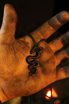 A hand forged Midgård/World serpent pendant . Comes supplied with a high quality elk leather thread. Viking Aesthetic, Loki Aesthetic, World Serpent, Leather Thread, Divine Mother, Norse Vikings, Norse Mythology, Greek Mythology, Gods And Goddesses