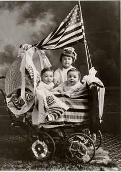 The American flag often appears at moments of patriotic celebration, but its use is generally guided by the Flag Code. These children in the early 20th century pose with a flag and other star-spangled decorations. This image is from the Faris and Yamna Naff Arab-American Collection.