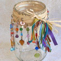 Mason Jar Luminary Beaded Candle Luminary Bohemian Hippie Candle Holder Multicolor Glass Beads. $24.00, via Etsy.