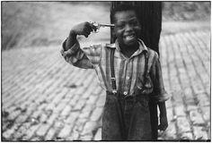 Elliot Erwitt  Boy with Gun  Pittsburg, PA 1950.