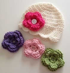Ravelry: Newborn to 10 Year Old Size Hat with Interchangeable Flowers pattern by Kim Duren