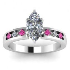 Marquise Cut White & Pink Sapphire Diamond Engagement Ring - Pretty stones are embedded in this 14k White Gold Marquise Cut White & Pink Sapphire Diamond Engagement Ring placed in a Channel setting featuring a White Marquise cut center stone with 6 White & Pink Sapphire accent stones. The Marquise White & Pink Sapphire engagement ring comes with an SI1 in clarity as well as an H in color. The gem weight is equal to .80 carats. The diamonds are 100% natural. #unusualengagementrings