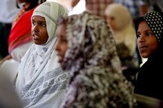 Nimo Adan, 16, left, and sister Hawo Adan, 10, far right, of Somalia, now reside in Houston. They were among visitors Saturday to the University of St. Thomas to celebrate World Refugee Day with cultural entertainment and educational exhibits. Photo: Gary Coronado, Staff / © 2015 Houston Chronicle