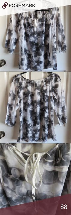 Black and White Floral Blouse Light wear, great condition! Light and flowy black and white floral blouse Tie string on neckline  100% polyester AB Studio Tops Blouses