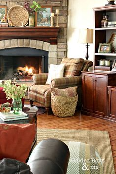 Corner stone fireplace in family room with leather sofas and plaid chairs-www.goldenboysandme.com