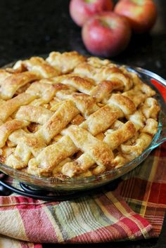 The Best Apple Pie Ever | the secret is you brush the remaining 1/3 cup caramel filling over the crust OMG Delicious !!! ~2 batches of my one minute homemade pie crust (or 1 if you roll it out very thinly!) •7-8 small granny smith apples, peeled, sliced, and cored •1 stick butter •3 T all-purpose flour •1/4 c water •1/2 c white sugar •1/2 c brown sugar •1 heaping tsp cinnamon 1/4 tsp nutmeg •1 tsp vanilla