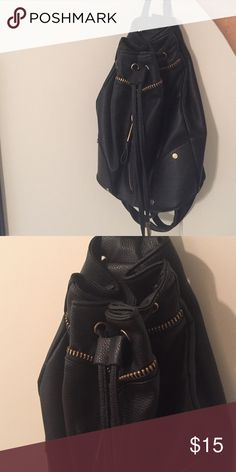 River island top shop black mini backpack Lightly used mini backpack with zippers and ties from river island, top shop style, makes for a great handbag looks much more expensive than it is! I have too many backpacks so please make an offer River Island Bags Backpacks