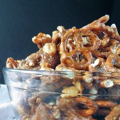 Caramel Crunch Snack Mix is loaded with nuts and pretzels all covered in a crunchy, rich caramel coating. Makes a great gift!