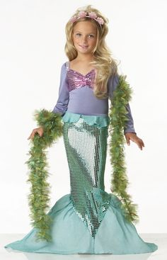 Little Mermaid Glamour Halloween Costume - Be part of this underwater world in this cute Mermaid dress. This costume is one piece made from stretchy fabric and boasts a sequin mermaid tail. The top is an attached lavender purple long sleeve shirt with faux sequin seashells and iridescent sequins lining the shoulders. The sparkly tail has a stiff fabric that can be formed to make the tail. #mermaid #fairytale #costume #yyc #calgary #girls