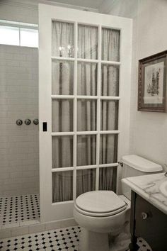 Love this idea with the french door as a shower door. How creative for a walk-in shower!