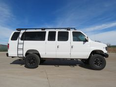 1999 Ford E-350 Extended 15 Passenger 4x4 Van (12552) - 96k mile original Texas fleet lease van that came out of oil and gas, Halliburton. We purchased it on lease return and have done the conversion and build out in house. It features an overbuilt 4 link coil spring conversion with a host of new parts, totally redone interior with 2013 seating, a sharp low profile roof rack with custom lighting, and new wheels/tires.