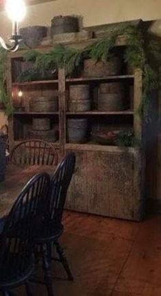I love the evergreen swag in this primitive dining room. - I love the evergreen swag in this primitive dining room. Primitive Homes, Primitive Living Room, Primitive Kitchen, Primitive Antiques, Country Primitive, Primitive Cabinets, Primitive Furniture, Rustic Furniture, Vintage Furniture