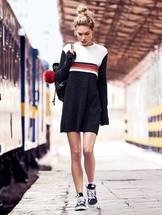 Colorblock Swit Mini Dress | Retro-inspired mock neck sweater dress featuring striped detailing. Effortless in a slouchy fit, this mini dress features a subtle flared sleeve and features an exposed zip closure in back.