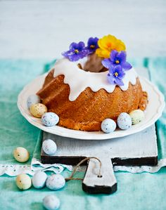 bundt cake with Robins Eggs and flowers for garnishing.
